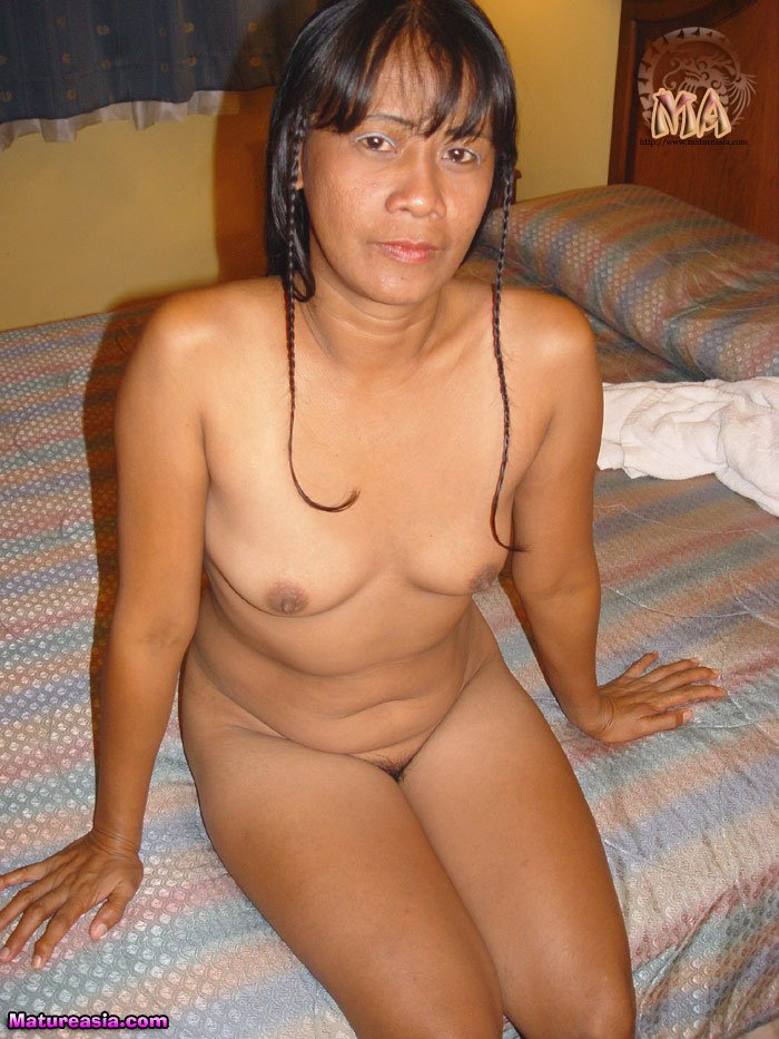 dark skinned amateur asian grandma taking a shower before